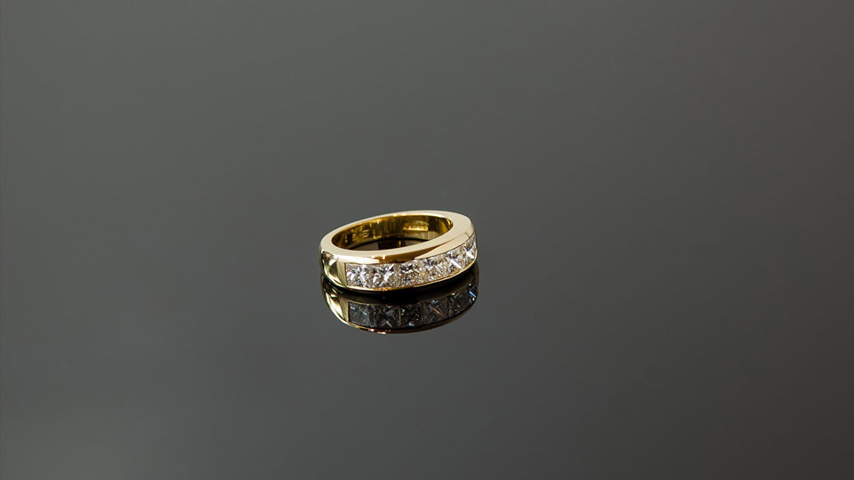 Diamond and gold ring on glass