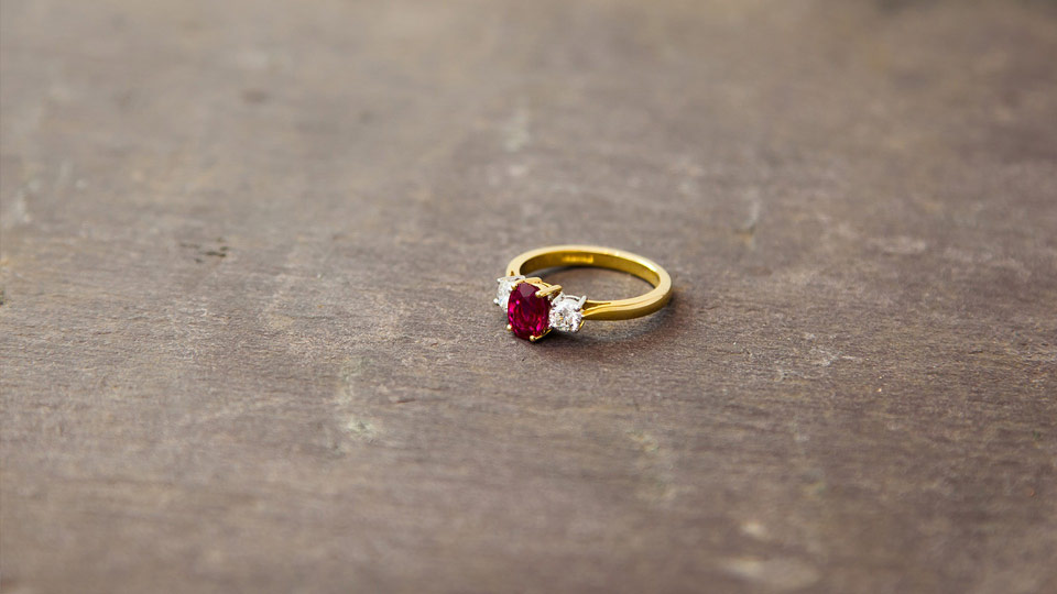 Ruby and gold ring on slate