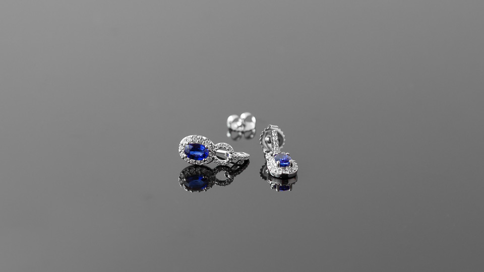 Sapphire ear rings on glass
